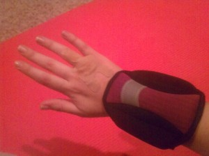Nifty ankle weights on my wrists.   I love my Hot Pink workout mat BTW :)